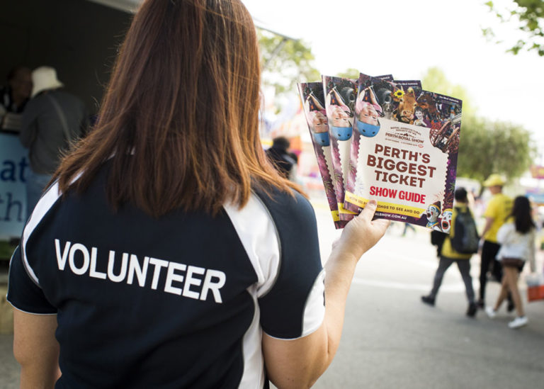 Perth Royal Show Volunteer handing out Show Guide